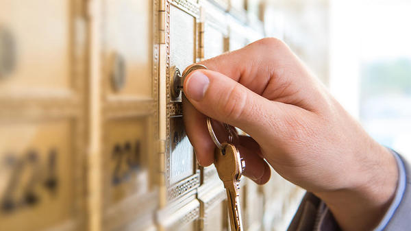 Close up photo of customer unlocking mailbox