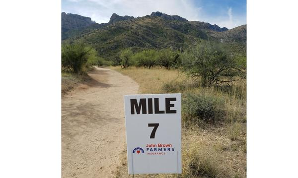 "A sign that reads ""Mile 7 John Brown Agency"""
