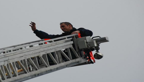 A brave fireman from the town of Waukesha, 10 stories up in the air over Hwy 59