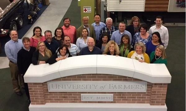 Farmers agents pose at University of Farmers