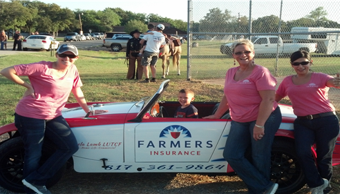 Farmers agency employees posing at Lake Side, TX National Night Out