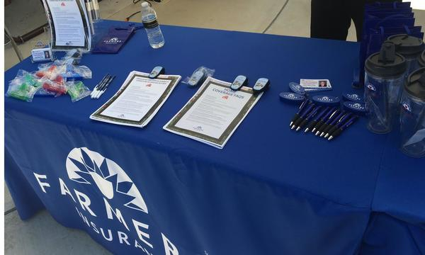 Blue Farmers® booth table with home insurance information.