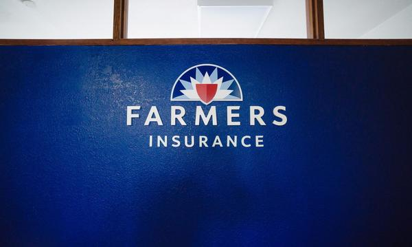 Blue Wall with Farmers Insurance Logo