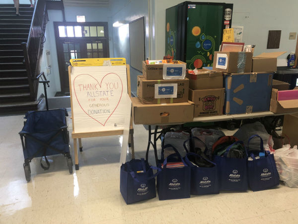 John Tunnell - Donating Supplies to Farnsworth Elementary School
