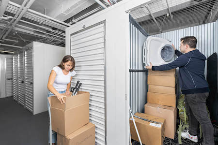Couple packs their storage unit with tennis rackets, baby stuff and more