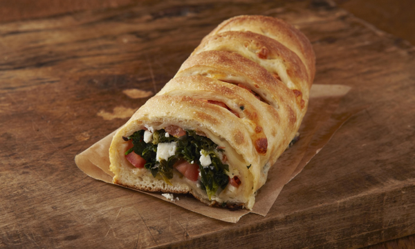 Greek Stromboli on a wood slab