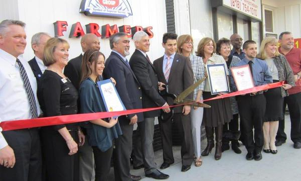 Farmers Agents at a ribbon opening for new agency.