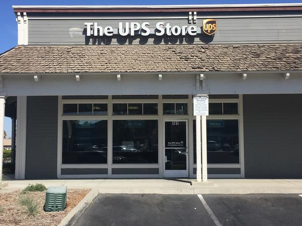 front of the ups store at 161 W Hanford Armona Rd