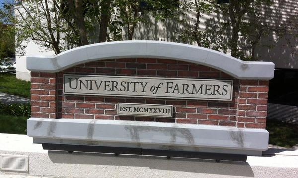 Farmers university front gate sign