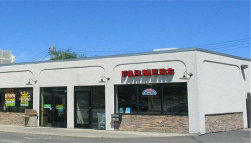 External shot of the Farmers Insurance agency on a clear day.