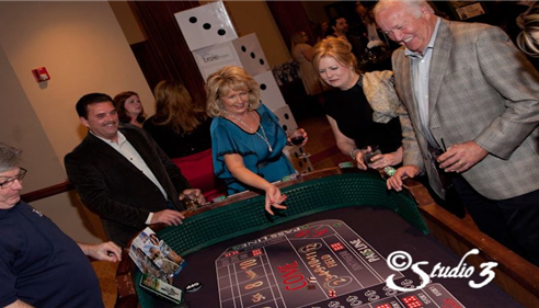People playing craps at casino table