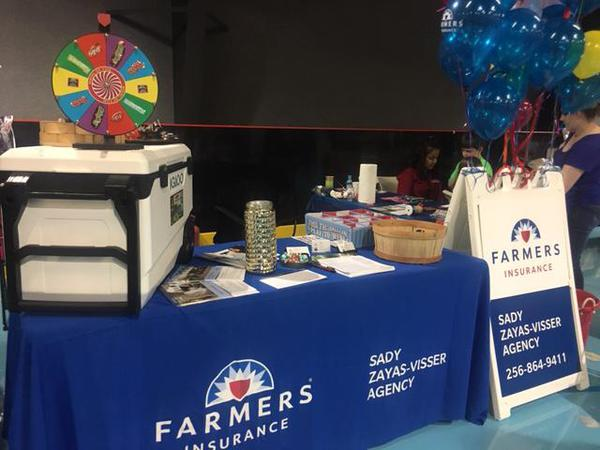 farmers information booth with cooler and raffle spinner