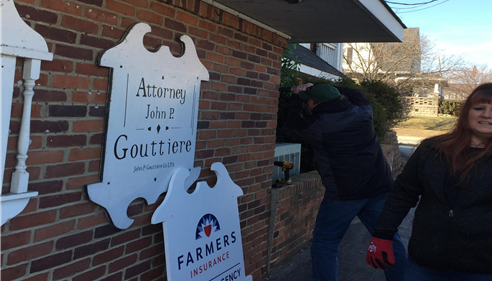 Installing our new sign on the front of the building.