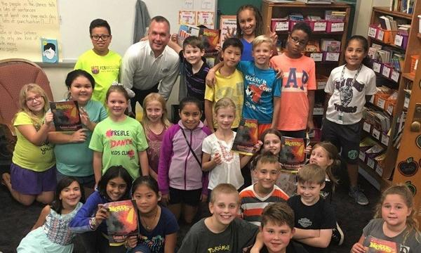Agent Scott Tarsi with a classroom of kids at a local school.