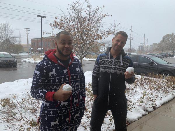 Two men holding snowballs