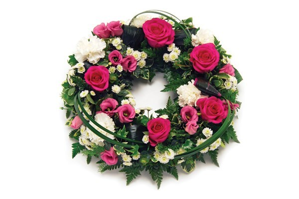 Our Modern Open Wreath, a rose floral tribute with a mix of pink and white flowers
