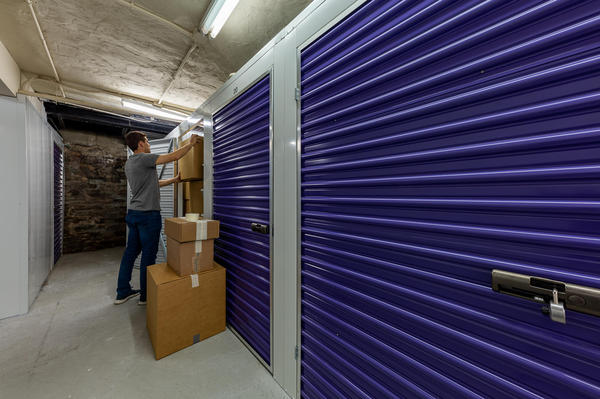 East Village storage facility with a man packing his storage unit