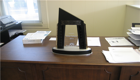 Championship award sitting on a desk