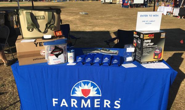 A promotional table for Farmers Insurance, the Robert Stephens Agency.