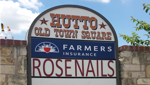outside sign with farmers logo