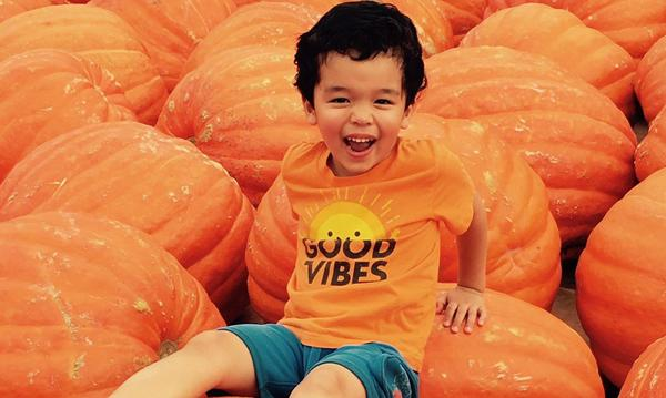 Agent Rani's son, Carter at a pumpkin patch.