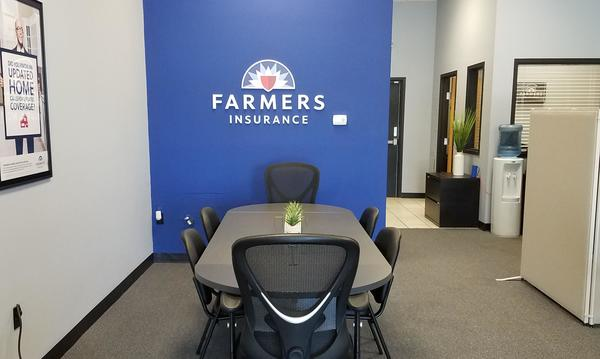 Conference table and our Farmers® logo.