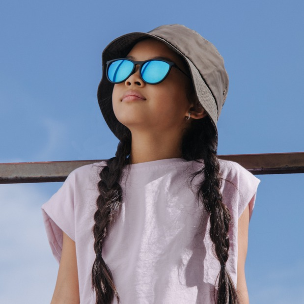 Young girl wearing Ray-Ban sunglasses