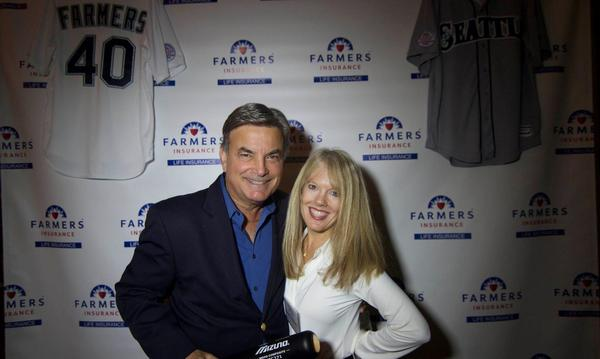 Isabelle poses with Rick Rizzs before a Farmers backdrop