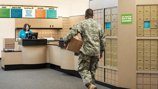 military officer dropping off package at the ups store