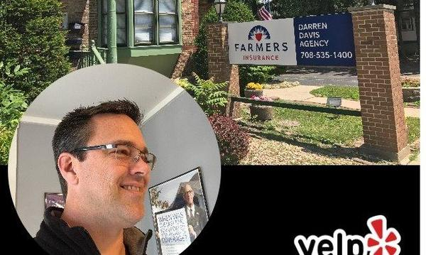 Agent with Farmers sign.