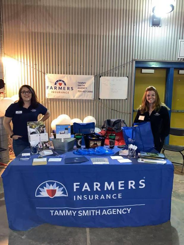 Agents at a Farmers booth