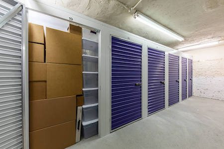 Storage unit packed with boxes