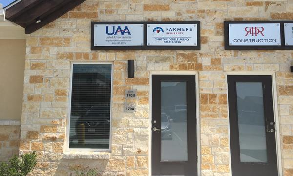 The front door and sign for Farmers Insurance Christine Degele Agency.