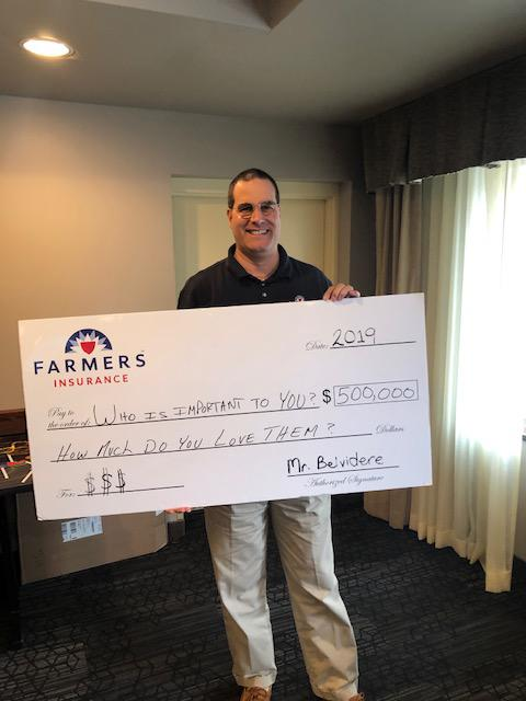 A person holding a large check
