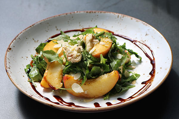 Peach & Mozzarella salad with arugula, balsamic, toasted almonds, and olive oil