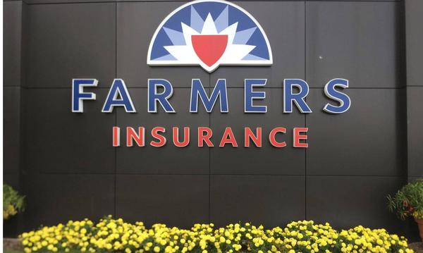 Farmers insurance logo on a black wall