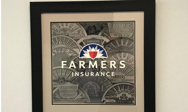Framed picture of a stylized Farmers Insurance logo