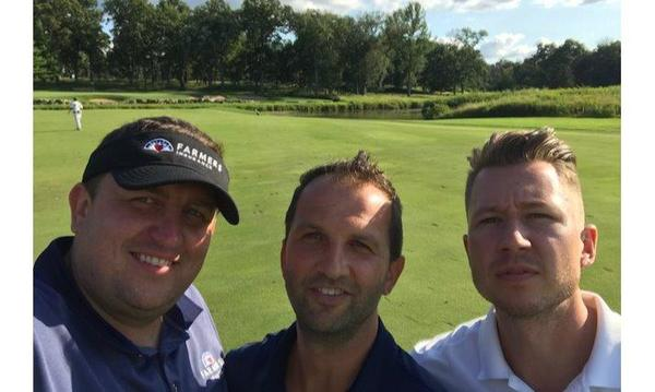 Three men on a golf course.