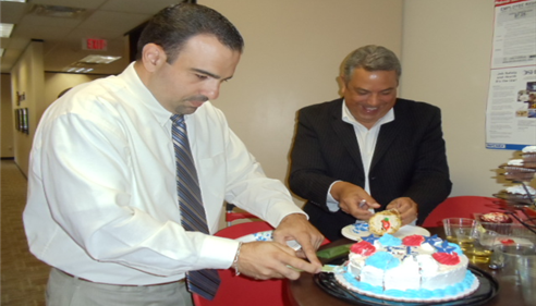Farmers Agent cutting cake