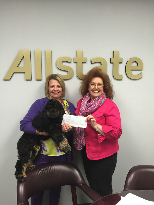 Terry Fincham - Agent Terry Fincham presenting Millie Loman a check for $1,000 from the Allstate Agency Hands in the Community Foundation.
