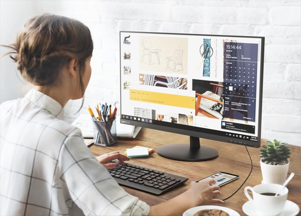 Woman using desktop design software.