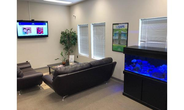 Office waiting area with TV and Fish Aquarium