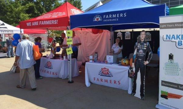 Red and blue Farmers insurance tents