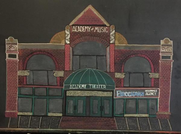A chalkboard drawing of the Historic Academy Theater