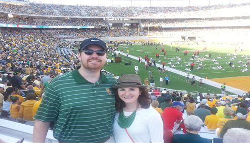 James and his wife, Alison, cheering on their Baylor Bears football team.