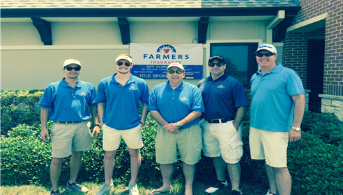 5 male staff members at golf tournament