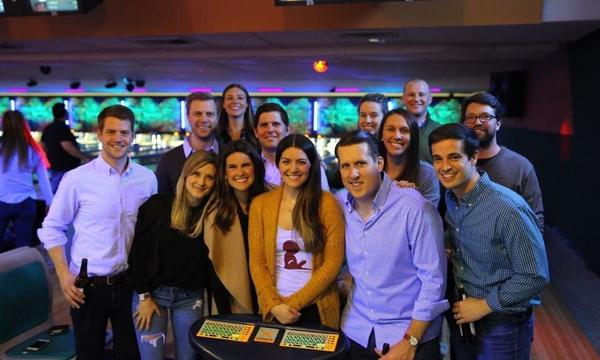 Group of people posing at a bowling alley for Bowling for Babies event