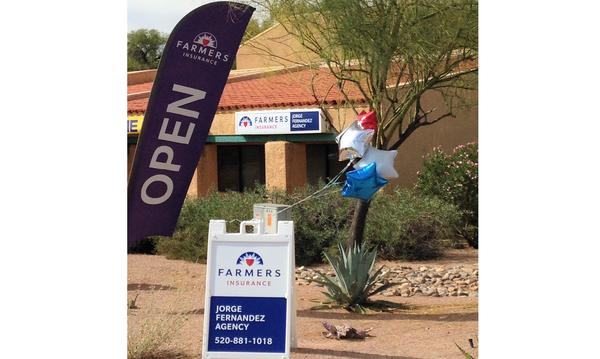 A blustery Tucson day blows through a red, white and blue bouquet of balloons.