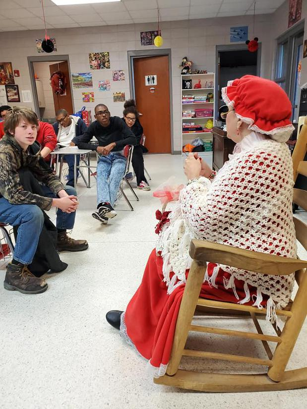 Ms Clause telling their story