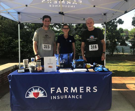 three agents at farmers table and tent